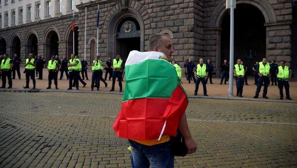 Uczestnik demonstracji antyrządowej w Sofii - Sputnik Polska
