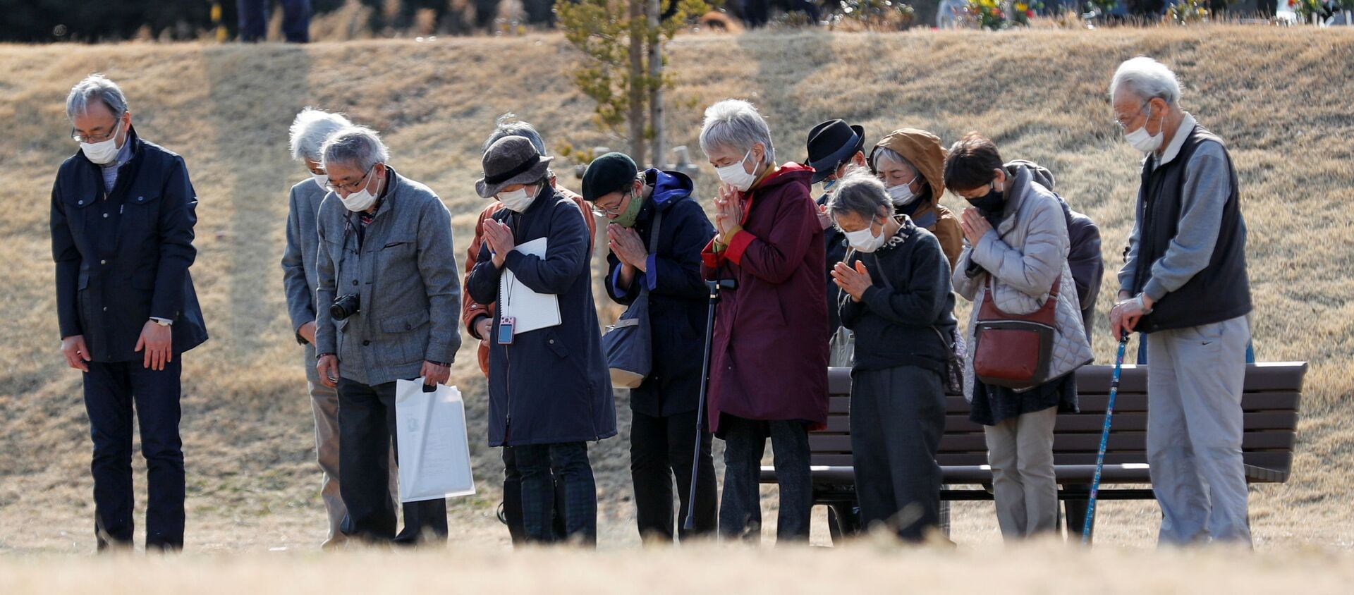 Japończycy uczcili minutą ciszy pamięć ofiar trzęsienia ziemi w 2011 roku - Sputnik Polska, 1920, 11.03.2021