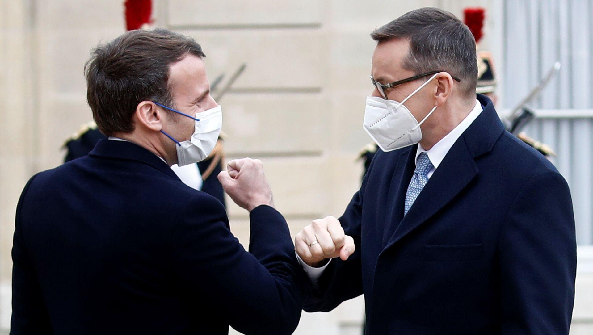 Premier Mateusz Morawiecki i prezydent Francji Emmanuel Macron - Sputnik Polska, 1920, 17.03.2021