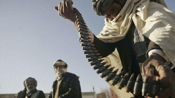 Бывший боец Талибана с патронами в руках - Sputnik Polska