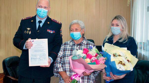 Награждение Светланы Санаровой из Новокузнецка, спасшей выпавшего из окна ребенка - Sputnik Polska