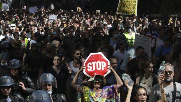 Акция против санитарных пропусков в Париже, Франция - Sputnik Polska