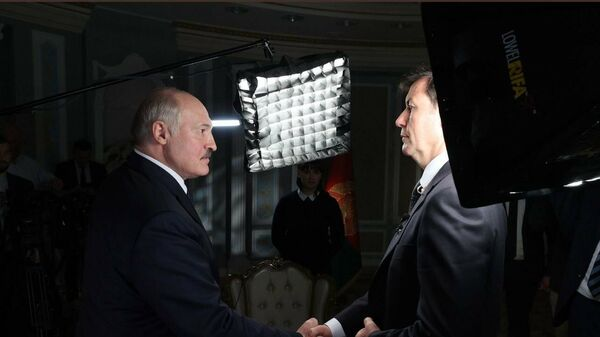 Prezydent Białorusi Alaksandr Łukaszenka i dziennikarz CNN - Sputnik Polska