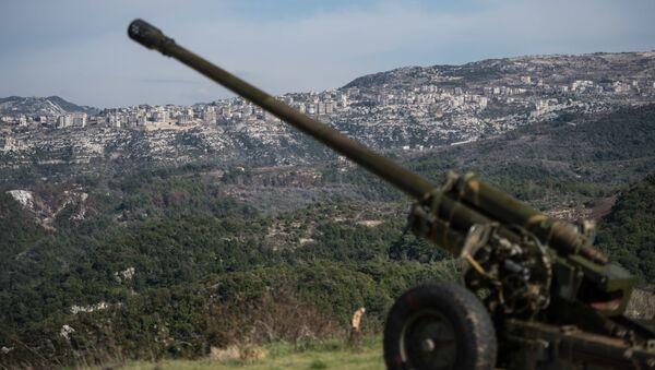 Syryjscy artylerzyści na stanowiskach w prowincji Idlib w północno-zachodniej Syrii. Archiwalne zdjęcie - Sputnik Polska