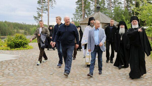 Prezydent Rosji Władimir Putin w czasie odwiedzin Wałaamskiego Monasteru - Sputnik Polska