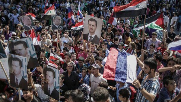 Wiec poparcia dla Baszszara al-Asada i Władimira Putina w Latakii, Syria - Sputnik Polska