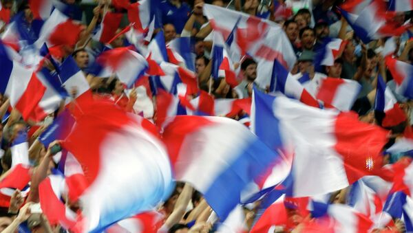 France's fans wave French flags during the France vs England rugby friendly match at Stade de France in Saint Denis, north of Paris, France, Saturday Aug. 22, 2015. - Sputnik Polska