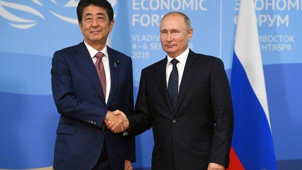 spotkanie Władimira Putina i Shinzo Abe - Sputnik Polska