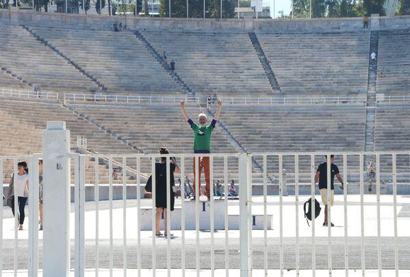 Turyści na stadionie Panathinaiko w Atenach  - Sputnik Polska