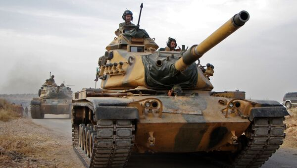 Tureccy żołnierze na amerykańskich czołgach M60 w syryjskim mieście Tukhar - Sputnik Polska