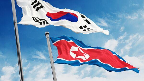 Flagi Korei Południowej i KRLD - Sputnik Polska
