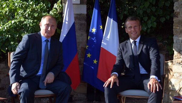 Prezydenci Rosji i Francji, Władimir Putin i Emmanuel Macron - Sputnik Polska