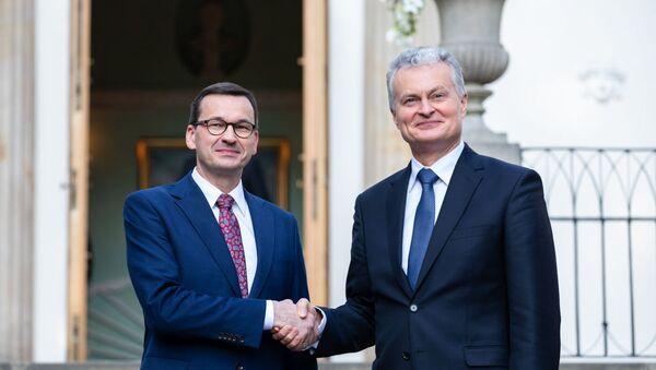 Premier Polski Mateusz Morawiecki i prezydent Litwy Gitanas Nauseda  - Sputnik Polska