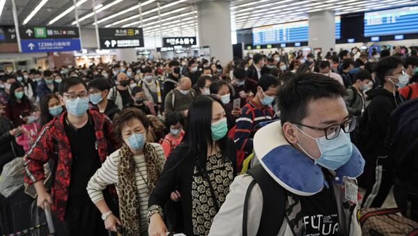 Pasażerowie w maskach, Hongkong  - Sputnik Polska
