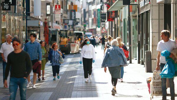 Ludzie na ulicy w Kolonii - Sputnik Polska