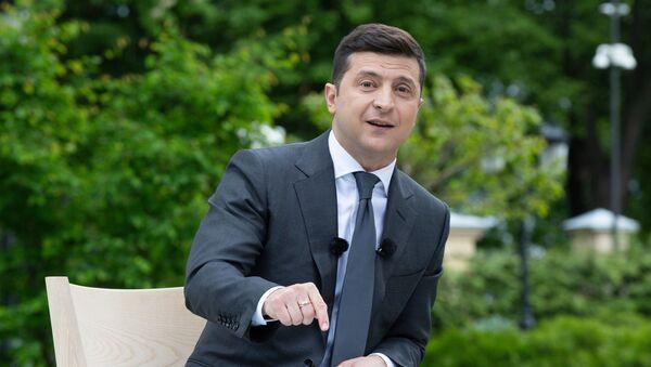 Prezydent Ukrainy Wołodymyr Zełenski w czasie konferencji prasowej poświęconej pierwszej rocznicy urzędowania na stanowisku prezydenta - Sputnik Polska