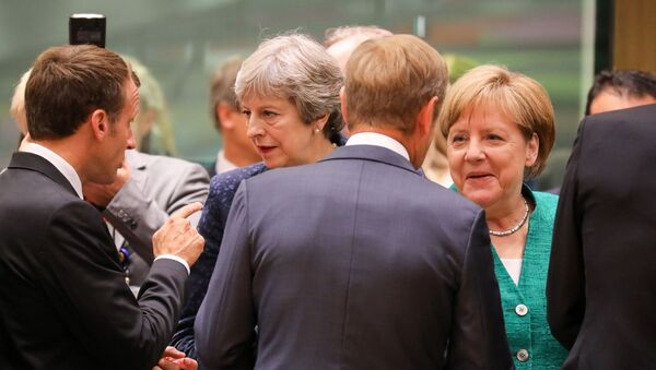 Angela Merkel i Theresa May - Sputnik Polska