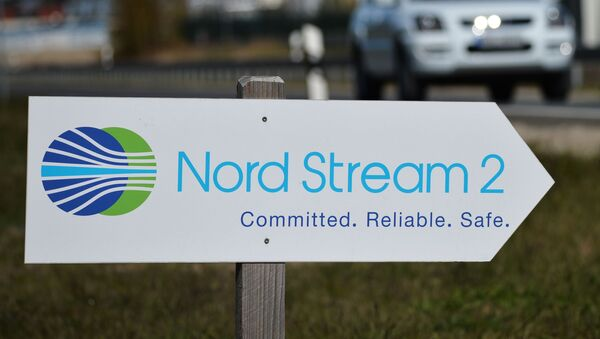 Drogowskaz z symboliką spółki Nord Stream 2 AG  - Sputnik Polska