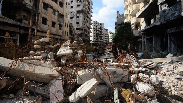 Zniszczone domy w mieście Hims w Syrii - Sputnik Polska