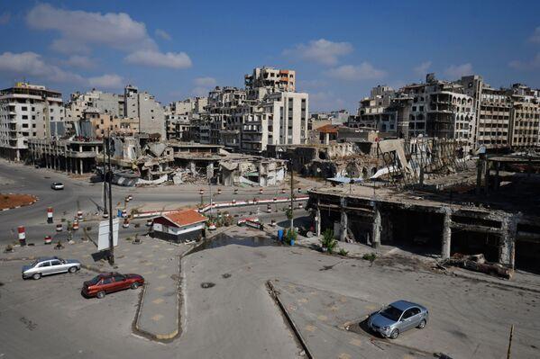 Zniszczone budynki w mieście Hims w Syrii - Sputnik Polska