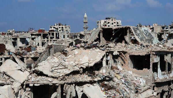 Zburzone bloki mieszkalne w mieście Homs, Syria - Sputnik Polska