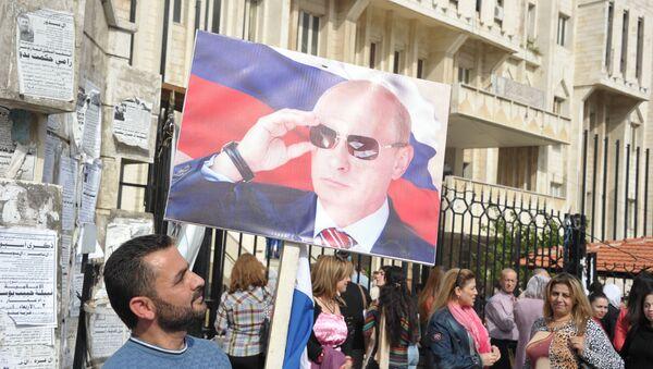 Miting w Latakii z okazji rosyjskiego Dnia Jedności Narodowej - Sputnik Polska