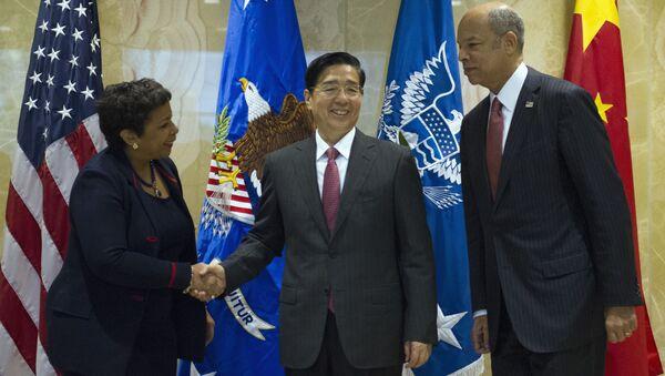 Minister bezpieczeństwa publicznego Chin Guo Shengkun, minister sprawiedliwości USA Loretta Lynch i minister bezpieczeństwa wewnętrznego USA Jay Johnson - Sputnik Polska