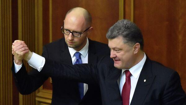 Premier Ukrainy Arsenij Jaceniuk i prezydent Petro Poroszenko - Sputnik Polska