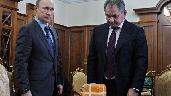 Prezydent Rosji Władimir Putin na spotkaniu z ministrem obrony Rosji Siergiejem Szojgu - Sputnik Polska