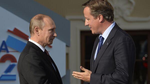 Prezydent Rosji Władimir Putin i premier Wielkiej Brytanii David Cameron w Petersburgu - Sputnik Polska