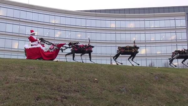 Kadr wideo pocztówki z saniami Santa Clausa, zaprzężonymi w roboty Cheetah opracowane przez firmę Boston Dynamics - Sputnik Polska