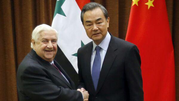 Minister spraw zagranicznych Syrii Walid Muallem i minister spraw zagranicznych Chin Wang Yi na spotkaniu w Pekinie - Sputnik Polska