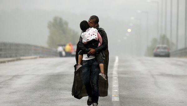 Syryjski uchodźca w pobliżu grecko-macedońskiej granicy - Sputnik Polska