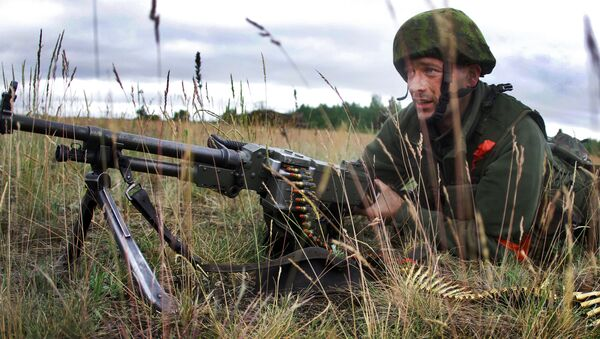 Żołnierz litewskiej armii podczas ćwiczeń wojskowych - Sputnik Polska