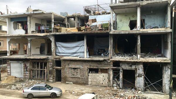 Zniszczony budynek w Homs w Syrii - Sputnik Polska