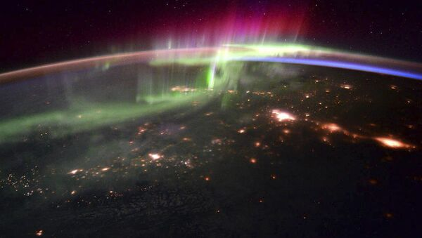 Zdjęcie zorzy polarnej wykonane z pokładu międzynarodowej stacji kosmicznej astronautą Scottem Joseph'em Kelly'em - Sputnik Polska