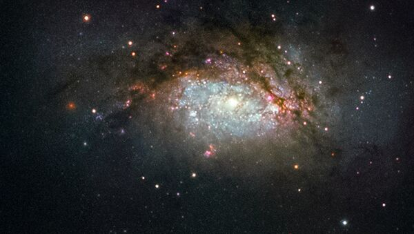 Galaktyka spiralna NGC 3597 - wynik zderzenia dwóch galaktyk - Sputnik Polska