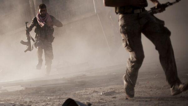 Żołnierze syryjskiej armii podczas działań zbrojnych w mieście Aleppo - Sputnik Polska