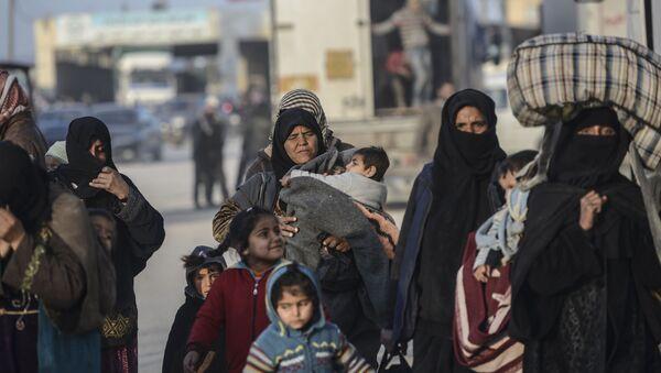 Syryjscy uchodźcy na turecko-syryjskiej granicy - Sputnik Polska