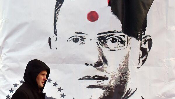 Plakat na Placu Niepodległości w Kijowie przedstawiający premiera Ukrainy Arsenija Jaceniuka - Sputnik Polska