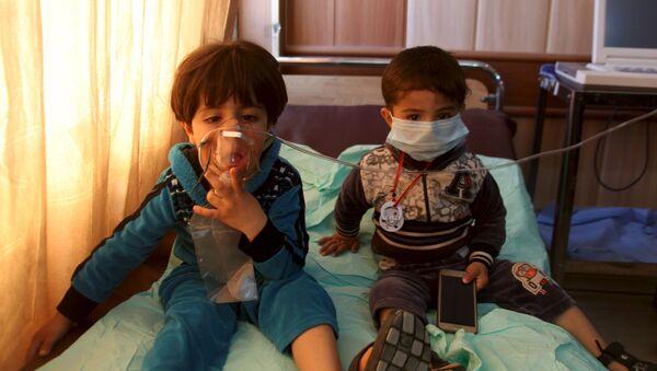 Ofiary ataku chemicznego w irackim mieście Taza - Sputnik Polska