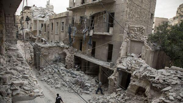 Ruiny na obrzeżach miasta Aleppo w Syrii - Sputnik Polska
