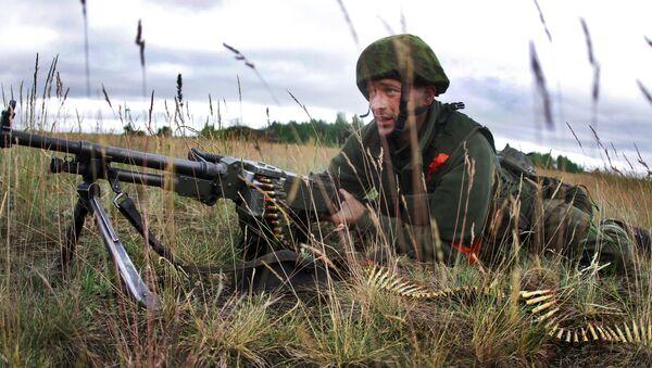 Litewski żołnierz podczas ćwiczeń wojskowych NATO Saber Strike 2014 - Sputnik Polska