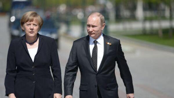 Prezydent Rosji Władimir Putin i kanclerz Niemiec Angela Merkel - Sputnik Polska