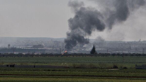 Dym nad syryjskim Idlibem - Sputnik Polska