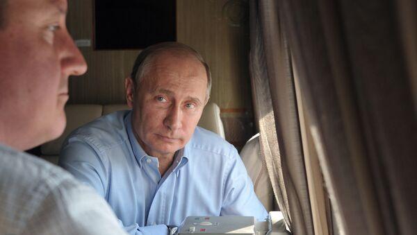 Władimir Putin i David Cameron obejrzali z helikoptera kompleksy dla Igrzysk Olimpijskich (2013). - Sputnik Polska