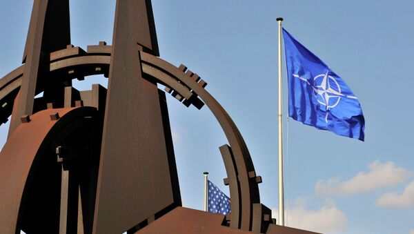 A picture taken on March 2, 2014 shows the NATO flag in the wind at the NATO headquarters in Brussels. - Sputnik Polska