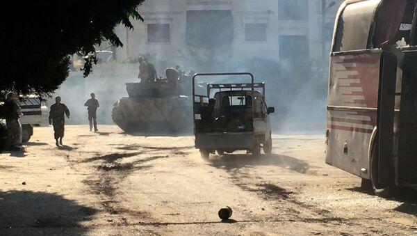 Bojownicy armii syryjskiej w czasie ofensywy w rejonie Aleppo - Sputnik Polska