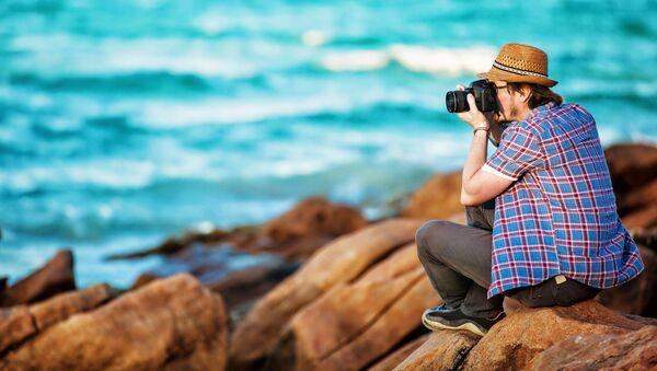 Fotograf na plaży - Sputnik Polska