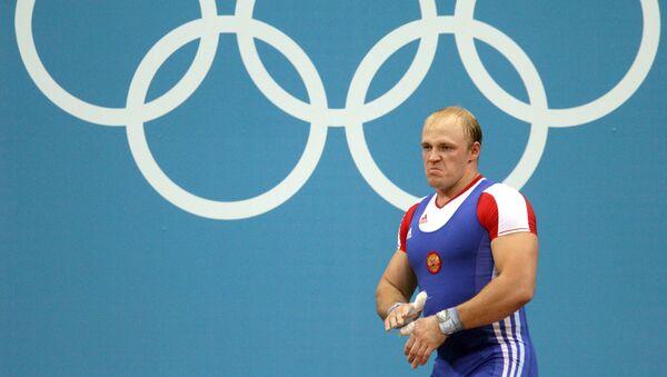 Rosjanin Andriej Demanow na zawodach w ciężkiej atletyce w kategorii wagowej do 94 kg (Londyn) - Sputnik Polska